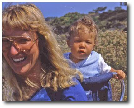 Image: Dr Angel Adams walking in the California hills with daughter